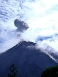 Arenal Volcano, Costa Rica. Erupts every 15 minutes.  It lets out its steam and you can hear the rock that come out bouncing against this volcano mountain Royalty Free Stock Images
