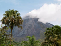 Arenal Volcano in Costa Rica. On a clear day. Smoke & steam coming out from the top cone Stock Photography