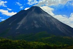 Arenal Volcano in Costa Rica. Volcano with exhalation and ash. Beautiful tropic landscape with volcano. Cone active volcano in Cen Royalty Free Stock Photo