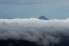 Arenal Volcano peaking thru the clouds Stock Image