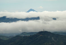 Arenal Volcano peaking thru the clouds Stock Photography