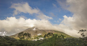 Arenal vulcan in costa rica. Cloudy arenal vulcan in costa rica at dawn Stock Photo