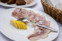Arenques cortados com sal e limão Imagens de Stock Royalty Free