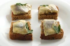 Arenques en el pan Foto de archivo