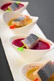 Arenques en salsa Imagenes de archivo