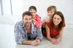 Arents and children posing on the floor indoors Royalty Free Stock Photo