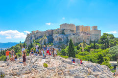 Areopagus in Athens, Greece. Athens, Greece - June 12, 2017: Tourists visit the Areopagus, a prominent rock with mythological associations in Athens, Greece Stock Photos