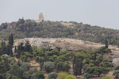 Areopagus Hill and Monument of Philopappos in Athens, Greece. Areopagus Hill and the Monument of Philopappos of Athens, Greece are shown during an afternoon day stock images
