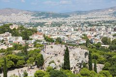 Areopagus rock with tourists and Athens Cityscape from the Acropolis, Greece royalty free stock photos