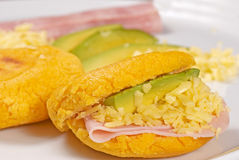 Arepas. Golden arepas filled with ham, cheese and avocado Stock Photography