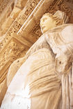 Aretia statue in Ephesus. Aretia, low angle closeup shot of statue which represent goddess of virtue in ancient Celsus library in Ephesus, Turkey Stock Photo