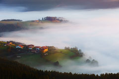 Arexola village in Aramaio foggy valley. At morning Royalty Free Stock Image