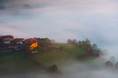 Arexola village in Aramaio foggy valley. At morning Stock Photo