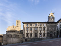 AREZZO. The northwest side of the Main Square: Exterior of the apse of Santa Maria della Pieve (left), Palace of the courts and the Palace of the Lay Fraternity( Royalty Free Stock Images