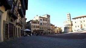 Arezzo Piazza Grande. People walking on the Piazza Grande in Arezzo stock video footage
