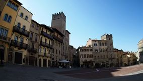 Arezzo Piazza Grande. People walking on the Piazza Grande in Arezzo stock footage