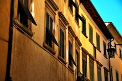 Arezzo. Tuscany Italy square palace sky windows cloud tower colors country lamp road street Stock Image