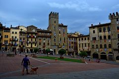 Arezzo. Umbria Italy dog square palace sky windows cloud tower colors country Stock Images