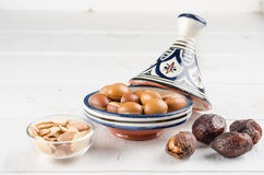 Argan fruit in a moroccan tajine Royalty Free Stock Photos