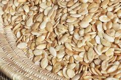 Argan kernels in basket. Stock Photos