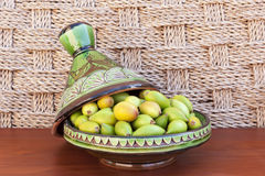 Argan nuts in a green plate. Royalty Free Stock Image