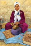 Argan oil. A Moroccan woman to the production of Argan oil royalty free stock photography