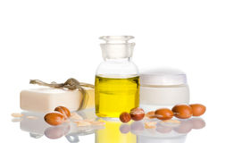 Argan oil with cosmetic products and fruits Royalty Free Stock Photography