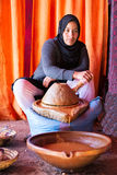 Argan oil. Moroccan woman while preparing argan oil in typical Moroccan cooperative Royalty Free Stock Photos