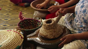 Argan oil production in a traditional way, Morocco stock footage