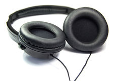 Arge black music headphones isolated on white background. Headphones Stock Photo