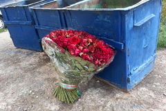 Arge bouquet of red roses thrown on the street the dump. The large bouquet of red roses thrown on the street the dump Royalty Free Stock Photography