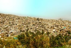 Arge garbage mountains The output of consumerism in underdeveloped countries. Waste from Urban Communities of Underdeveloped Countries Left behind by public Stock Photo