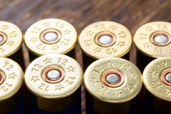 Arge number of hunting bullets on a wooden board, like a background. A large number of hunting bullets on a wooden board, like a background Royalty Free Stock Photography