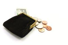 Argent. Bourse avec un dollar et pièces de monnaie Photos stock