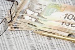 Argent canadien sur le marché boursier Images libres de droits
