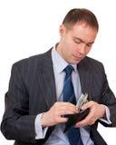 Argent comptant de compte d'homme d'affaires. photo stock