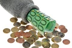 Argent comptant et pièces de monnaie dans la chaussette Photographie stock libre de droits