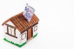 Argent d'économie pour acheter une maison Photographie stock