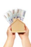 Argent d'économie pour une maison Photo stock
