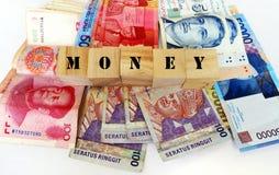 Argent dans des devises asiatiques image libre de droits