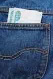 Argent dans des vos jeans de poche Image stock