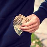 Argent dans la poche photo stock