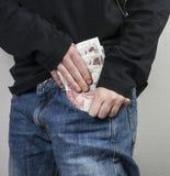 Argent dans la poche Image libre de droits