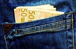 Argent dans la poche Image stock