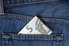 Argent dans la poche de pantalon Photographie stock libre de droits
