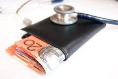 Argent dans les soins de santé Image stock