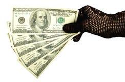 Argent dans une main femelle dans le gant Photo libre de droits