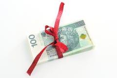 Argent de cadeau et ruban rouge Images stock