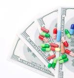 Argent de coûts de médecines Photo stock