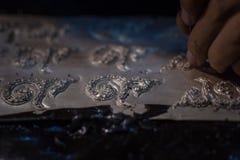 Argent de coup sec et dur d'artisan au numéro neuf Photographie stock libre de droits